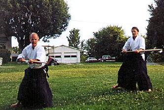 Dale Bruns & His Daughter Tess Practicing Aiki Jo Kata